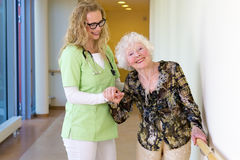 Medical Assistant Assisting Happy Elderly Patient Royalty Free Stock Photo