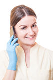 Medical assistant holding smartphone Stock Image