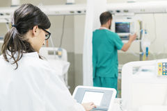 Medical assistant working with the medical technology Equipment Stock Photography
