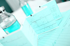 Medical background with bottle and ECG Stock Image