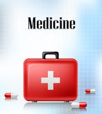 Medical background with first aid box and pills Stock Images