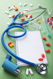 Medical background with notebook Stock Photography