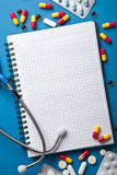 Medical background with notebook Stock Images