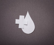 Medical background, Paper cut of blood drop and medical symbol Stock Images