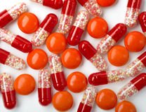 Medical background with red pills and red capsules Royalty Free Stock Photography