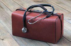 Medical bag and stethoscope. On the wooden table Royalty Free Stock Photo