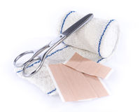 Medical bandage with scissors and sticking plaster Royalty Free Stock Photography