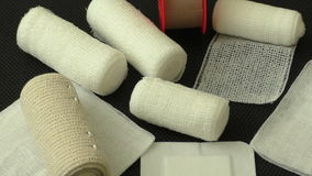 Medical bandages and gauze rolls stock footage