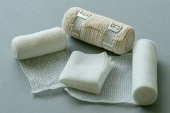 Medical bandages on gray background. stock photos
