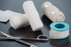 Medical bandages with scissors and sticking plaster Royalty Free Stock Photo