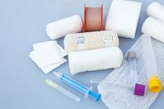 Medical bandages with sticking plaster and syringes Stock Photography