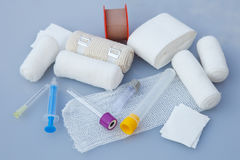 Medical bandages with sticking plaster and syringes Stock Photo