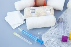 Medical bandages with sticking plaster and syringes Stock Image
