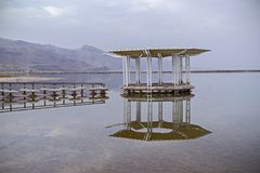Medical beach on the Dead Sea-famous health psoriasis treatment. Resort.Round gazebo in the water near the water`s edge in the Ein Bokek, Israel Stock Photography