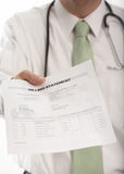 Medical Bill. Doctor handing medical billing statement to patient Royalty Free Stock Image