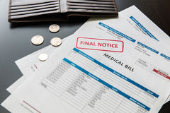 Medical bill from the hospital, concept of rising medical cost. Medical bill from the hospital, concept of rising medical cost, selective focus.  All data on Stock Images