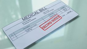Medical bill second notice, hand stamping seal on document, payment for services. Stock footage stock video