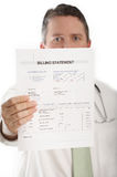 Medical billing. Doctor showing medical billing statement, DOF focus on bill Royalty Free Stock Photo