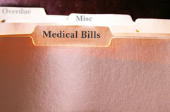 Medical Bills. Tabbed folders with Medical Bills text Royalty Free Stock Images