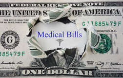 Medical Bills message with torn dollar bill Royalty Free Stock Photo