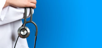Medical blue background doctor. With a stethoscope royalty free stock image