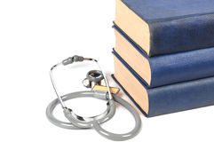Medical book. Stethoscope and  medical books with white   background Royalty Free Stock Image