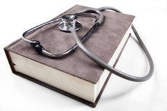 Medical book and stethoscope Stock Image