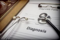 Medical book with a stethoscope and a diagnostic form. Conceptual image royalty free stock photo