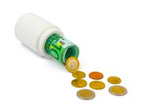 Medical bottle and money Stock Photography