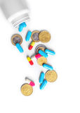 Medical bottle with pills and coins Stock Photos