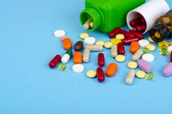 Medical bottle, red pills, treatment for cardiovascular diseases. Studio Photo stock photo