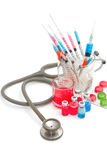 Medical bottles, ampoule, syringe and pills with stethoscope Royalty Free Stock Image
