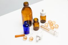 Medical bottles with dropper. In a cut out view royalty free stock photo