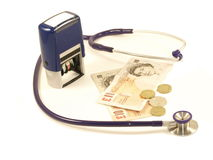 Medical business. Stethoscope,stamp and British money on isolated white background stock images