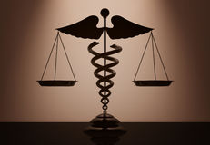 Medical Caduceus Symbol as Scales with backlight over Wall. 3d R Stock Photography