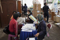 Medical camp. YOGYAKARTA, INDONESIA - AUGUST 4,2006: earthquake surveivers are receiving medical assistance in Bantul, after the earthquake near Yogyakarta on Stock Photo