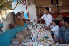 Medical camp. Medical staffs are attending pilgrims of Gangasagar fair at a camp in Kolkata Royalty Free Stock Photo