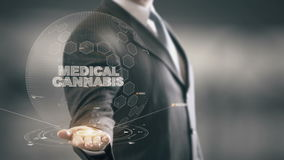 Medical Cannabis with hologram businessman concept