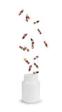 Medical capsule with berries fall into the bottle Stock Photography