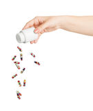 Medical capsule with berries flying out of the bottle Stock Images