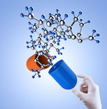 Medical capsule and molecule structure Royalty Free Stock Image