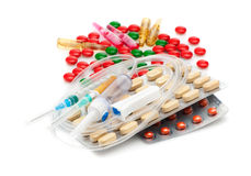 Medical capsules, pills, and syringes. Medical background Royalty Free Stock Images