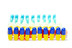 Medical Capsules and Tablets. Aligned capsules and tablets with white background royalty free stock photo