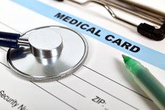Medical card and stethoscope Stock Images