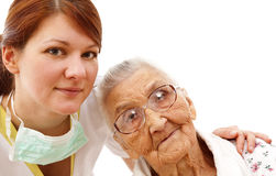 Medical care for an old woman Royalty Free Stock Photography