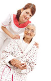 Medical care for an old woman Stock Images