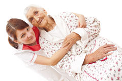 Medical care for an old woman Royalty Free Stock Image