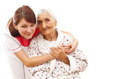 Medical care for an old woman Stock Image