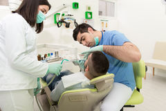 Medical Care A Patient With A Toothache Stock Photo