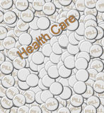 Medical Care with Pills. Background image shows large pile of pills.  Each tablet is white and the word PILL is embossed on each one.  Blank space allows for Stock Photos